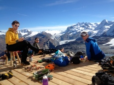 Living the dream! Sorting kit with Dave, Dave and Tim after our descent and just before the start of an epic journey back home to try and get to work on Monday morning!
